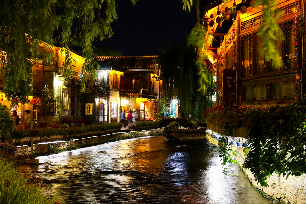 Water flows through the canals in Lijiang at night