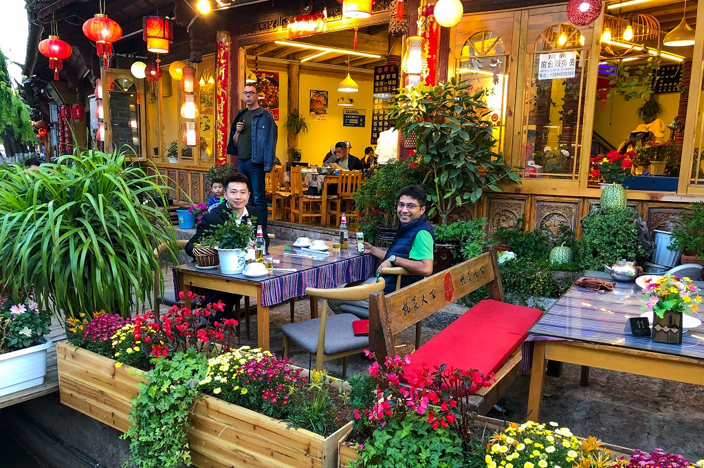 Kevin and Debarshi having dinner in Lijiang