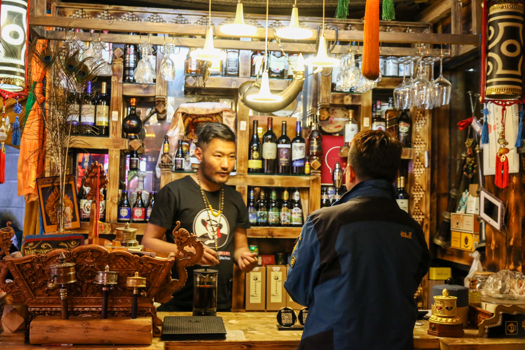 Sanjay the owner of AKDB Boutique Hotel finding liquor for us