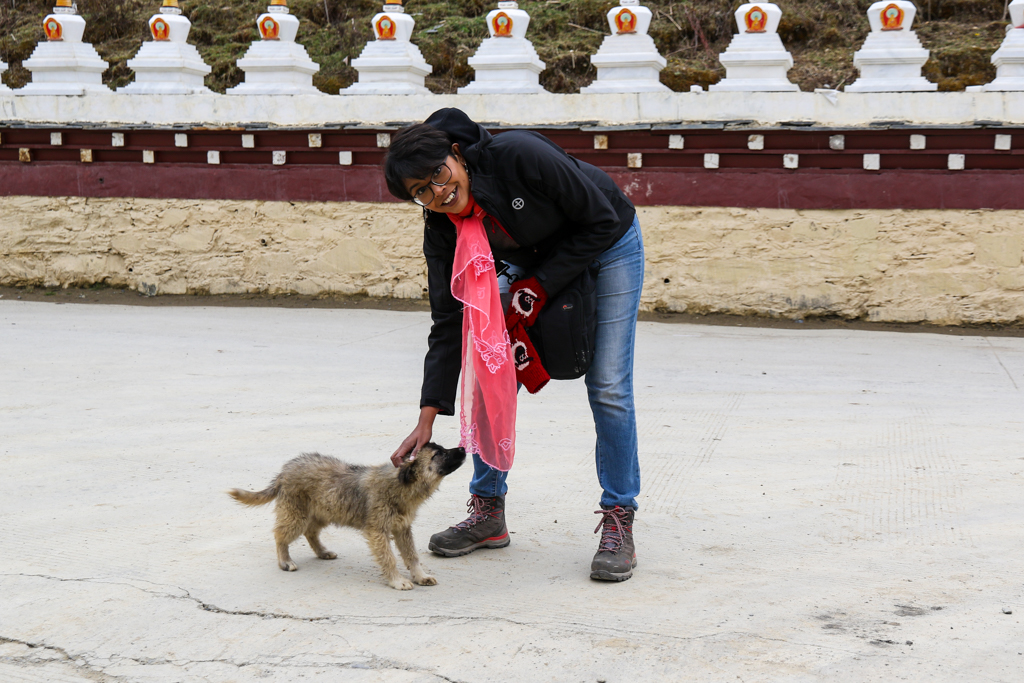 Chandrima playing with a puppy at Muya village
