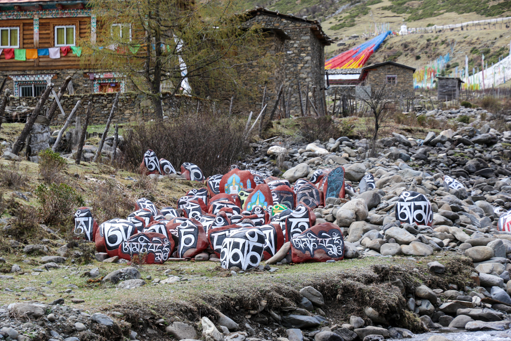 Sacred mantra painted on boulders near Moska