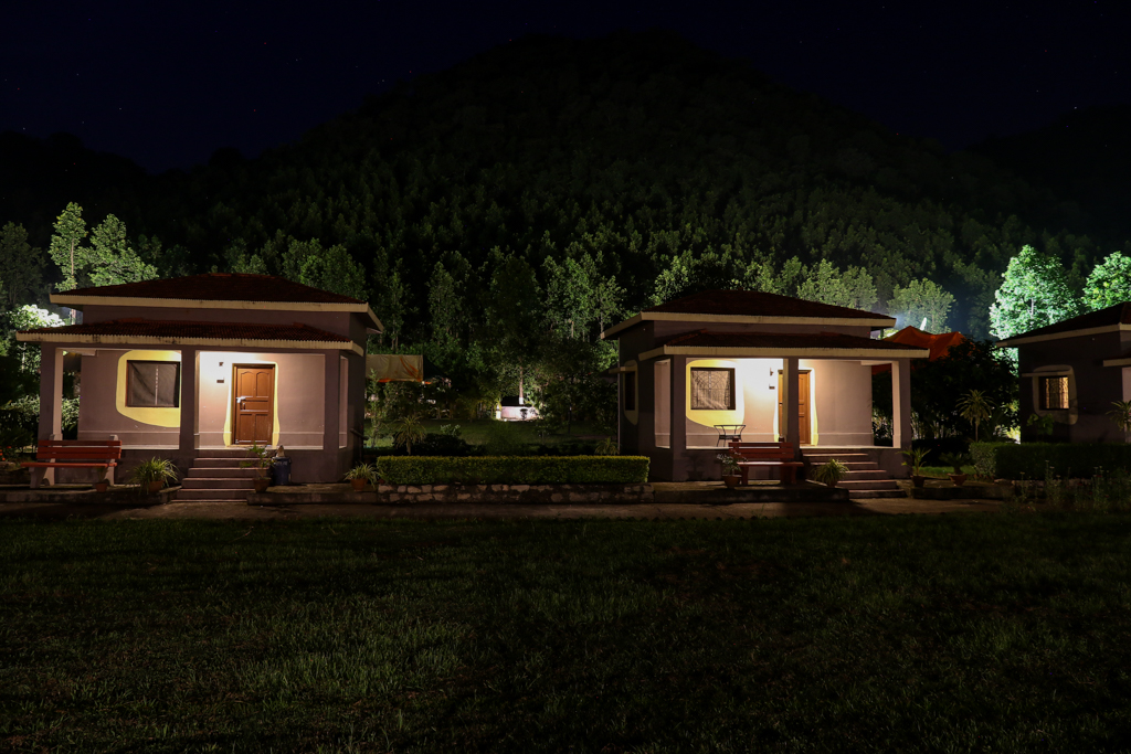 Khairabera eco adventure resort cottages at night